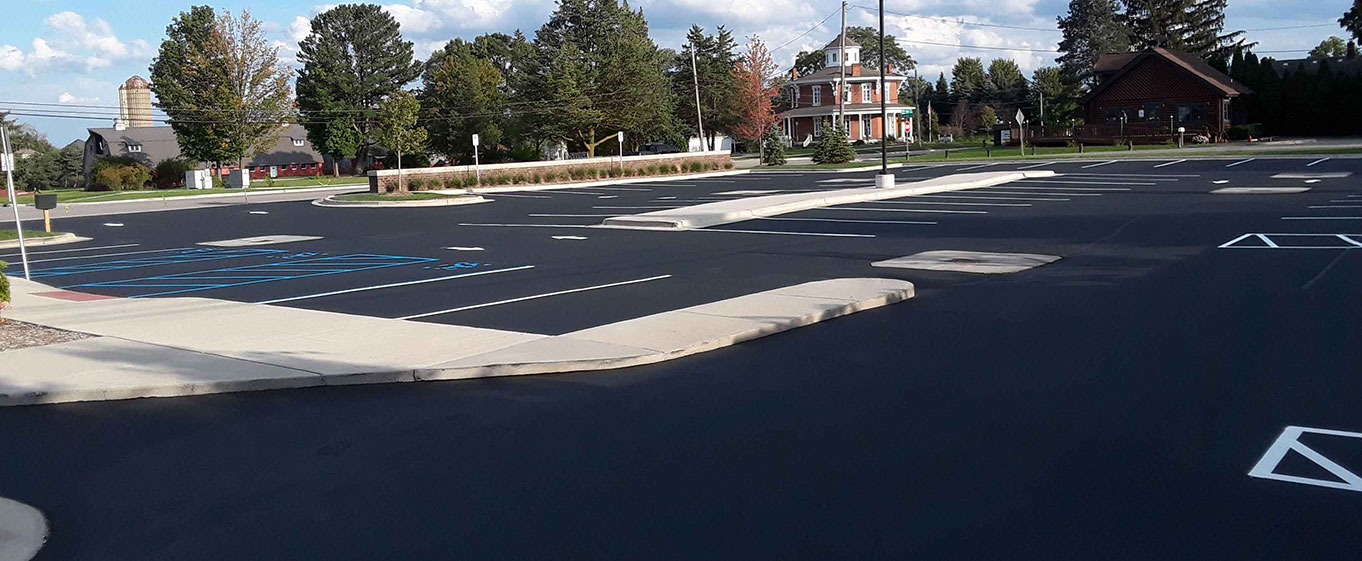 An asphalt parking lot in Michigan completely redone, with striping by Central Seal Coat